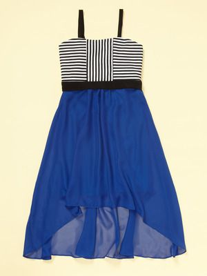 A Sally Miller Horizontal and vertical striped top half of the dress and a blue bottom of the dress, shorter in the front and longer in the back with black straps. #sallymiller