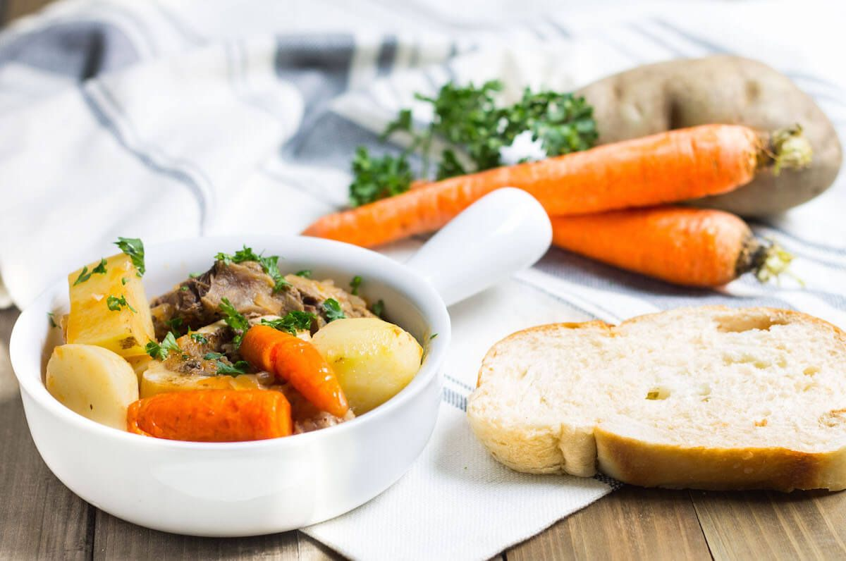 This pot au feu is a classic French stew made up of slow-cooked beef, carrots, and potatoes. Perfect for a cozy weeknight meal.