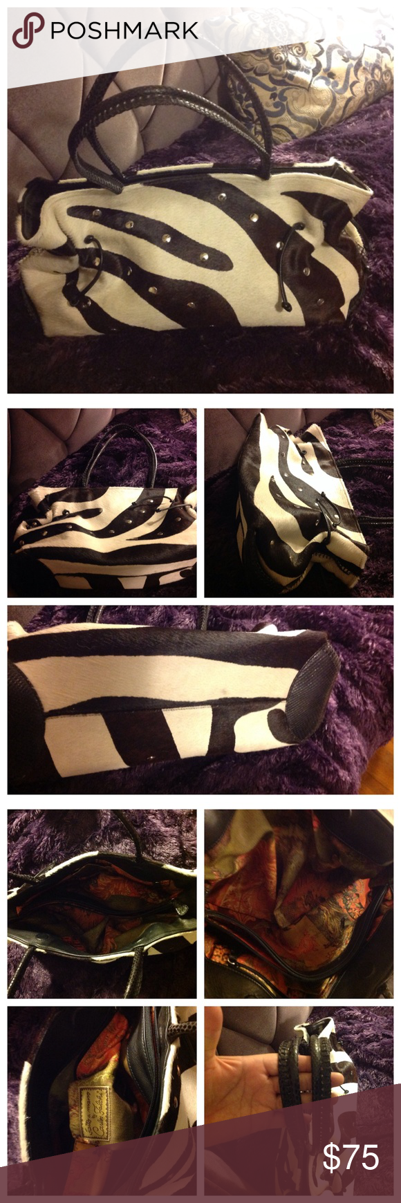 """Black white studded calf hair Carlos Falchi Bag Great, great calf hair bag that looks fabulous on the shoulder. This """"carpet bag"""" fits a ton and has lots of pockets to keep you organized. It's by Carlos Falchi """"Fatto a Mano,"""" and it is either calf hair or pony hair. Lovelier in person, this black and cream bag is a great winter bag! Calf hair shows some wear at the bottom ( see noticeable spot on bottom). Nice studs really set this bag off. Carlos Falchi Bags Satchels"""
