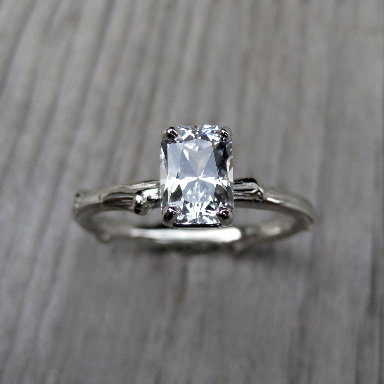 How gorgeous is this Emerald Cut White Sapphire Twig Engagement