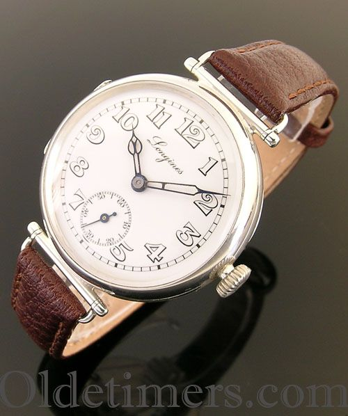 An early silver round vintage Longines watch, 1916