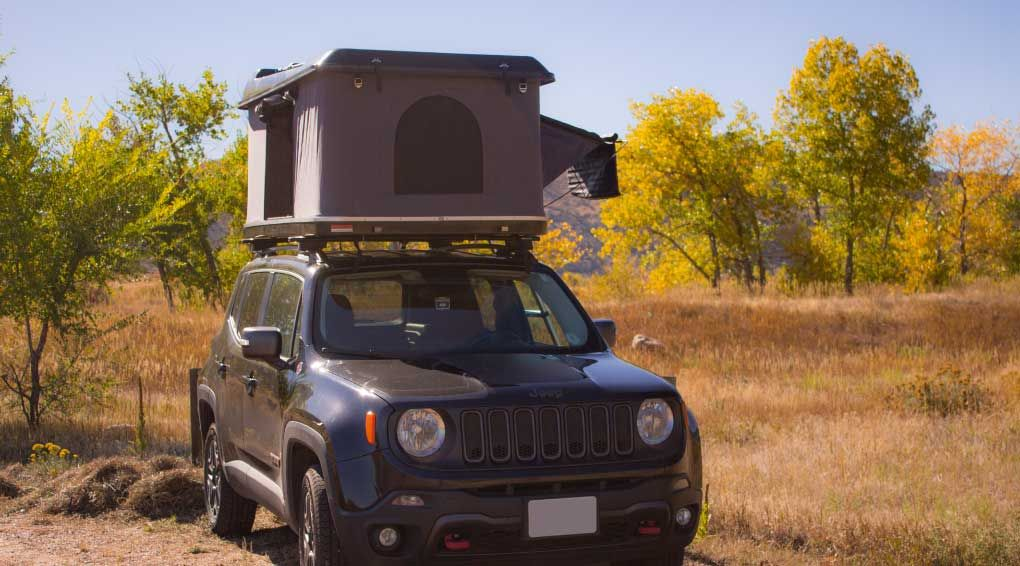 The Overroam Roof Top Tent From Denver Outfitters On Top Of A Jeep