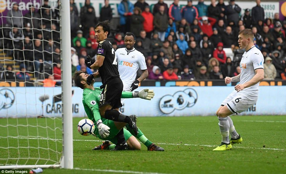 Shinji Okazaki doubled Leicester's lead early in the second half with a bundled finish following a pass from Riyad Mahrez
