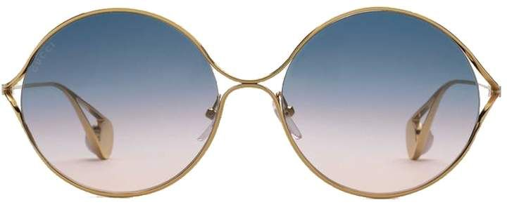 a788d9d633  Gucci Iridescent  Round  Sunglasses. Round retro lenses with shining  butterfly frames and medallion-tipped temples. 100% UVA UVB protection Made  in Italy.