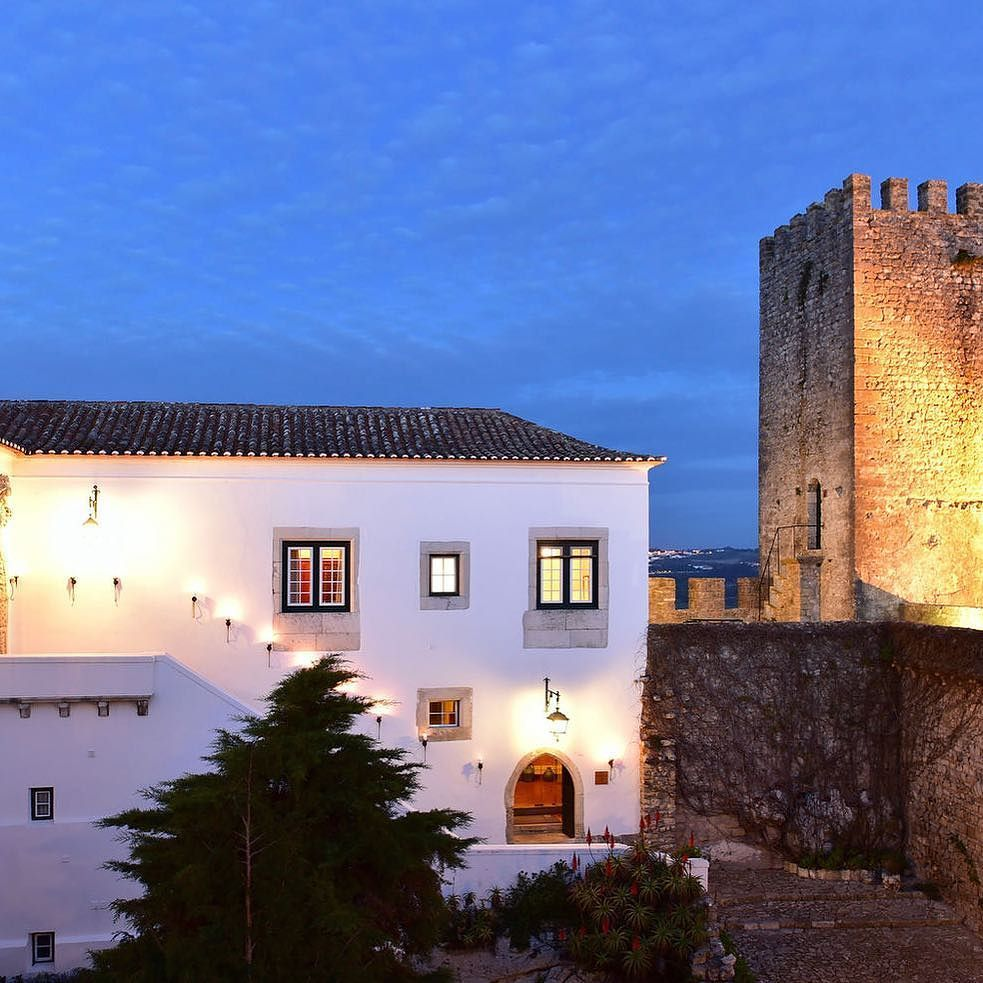 With Its Many Tapestries Ancient Chests And Suits Of Armor This Ornate Portuguese Castle Transports Guests Back To A Medieval Worl Mansions Castle House Property