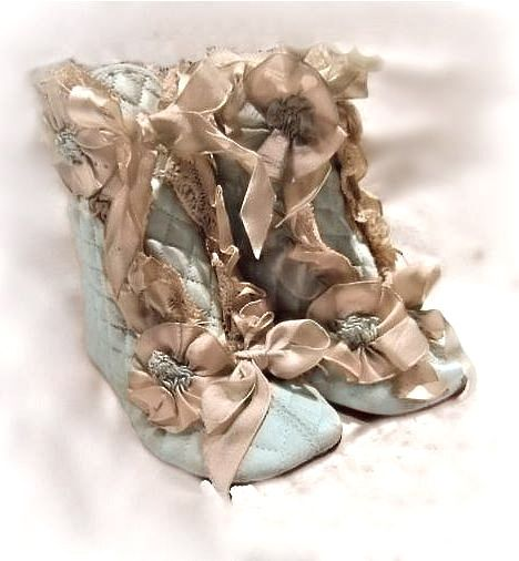 antique quilted silk baby boots decorated with lace and ribbon rosettes ... ca. 1900