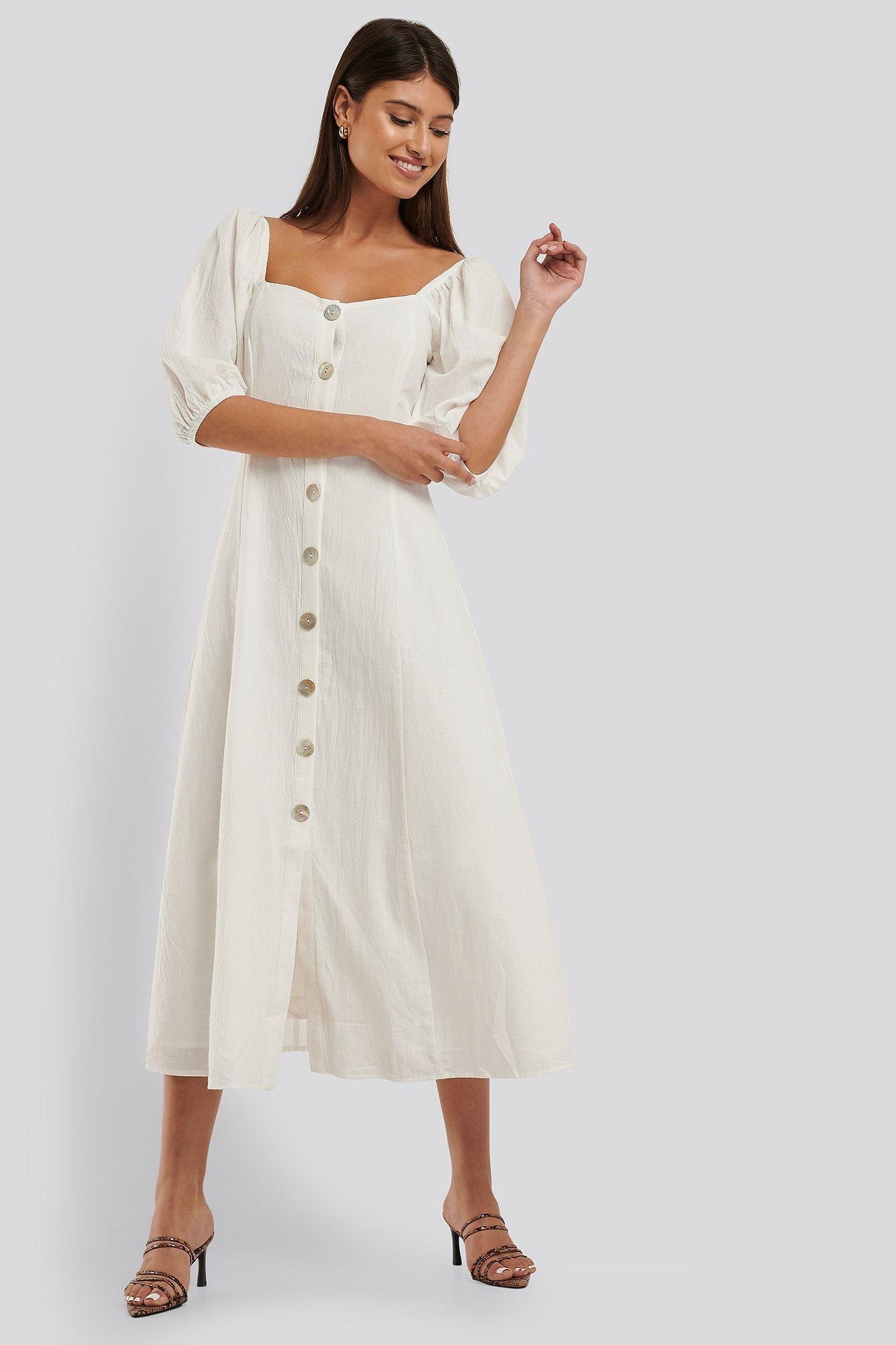 knälång klänning längd