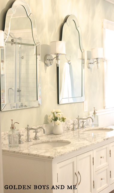 double vanity with two curvy mirrors elegant master bath remodel featured on remodelaholiccom - Bathroom Remodel Mirrors