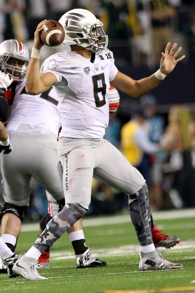 Buckeyes run past Ducks to win first-ever College Football ...