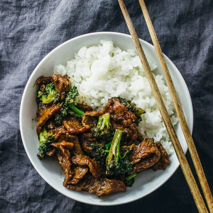 This beef and broccoli recipe is CRAZY GOOD. It's so easy and quick to make this authentic Chinese stir fry using flank steak seared on a skillet or wok. The sauce is simple to make and not spicy -- all you need are soy sauce, brown sugar, and corn starch. This recipe for two yields the best beef and broccoli bowl that you can pair with rice for a gluten free dinner. Perfect when you have Asian takeout cravings for Panda Express or PF Changs. #beef #broccoli #dinner via @savory.tooth