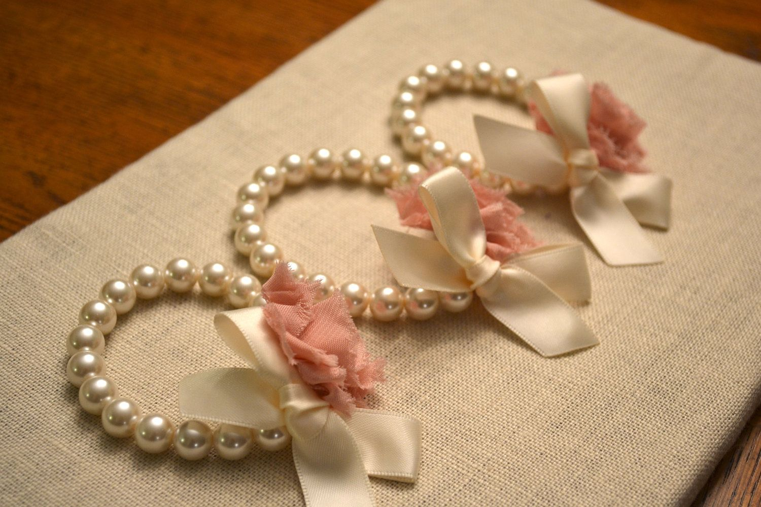 Grace ivory pearl corsage bracelet with ivory ribbon and dusty rose