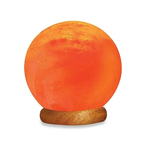 Languor In The Warm Glow Of The Himalayan Ionic Crystal Sun Globe Salt Lamp.  The