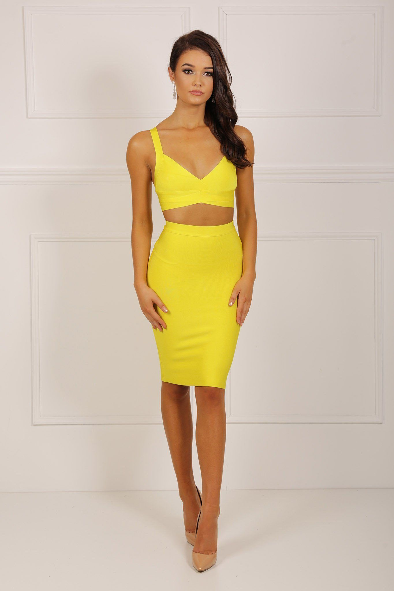 be1c81782 Two-piece bandage dress set including bralette style crop top and midi  pencil skirt in yellow color
