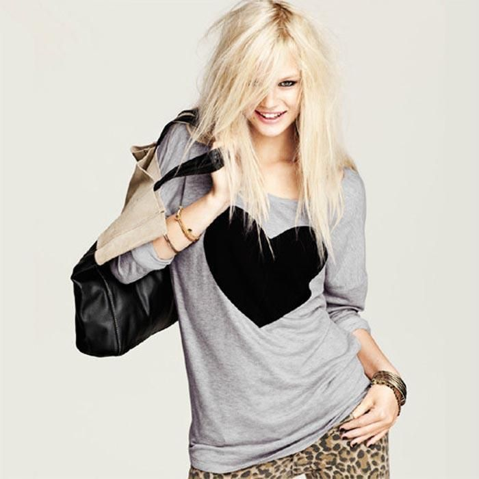 """When it comes to chic, laid-back style, this shirt has you covered! This Black Heart Long Sleeved Shirt will be your go-to casual yet trendy look. Grey long sleeved shirt, featuring a round neck, black heart print in front, soft cotton fabric and a loose fit finish. Note: Please refer to the size chart for measurements when ordering. No two designers are alike on sizing. Size Bust Shoulder To Sleeve Length S 40.9"""" 18.5"""" 24.8"""" M 42.5"""" 18.9"""" 25.6"""" L 44.1"""" 19.3"""" 26.4"""" XL 47.2"""" 19.7"""" 27.2"""" Material:"""