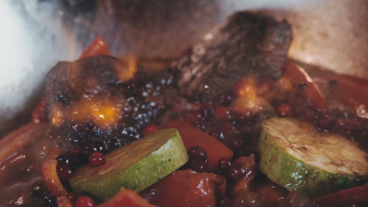Photo of Vegetables and meat stew over an open fire Stock Footage #AD…
