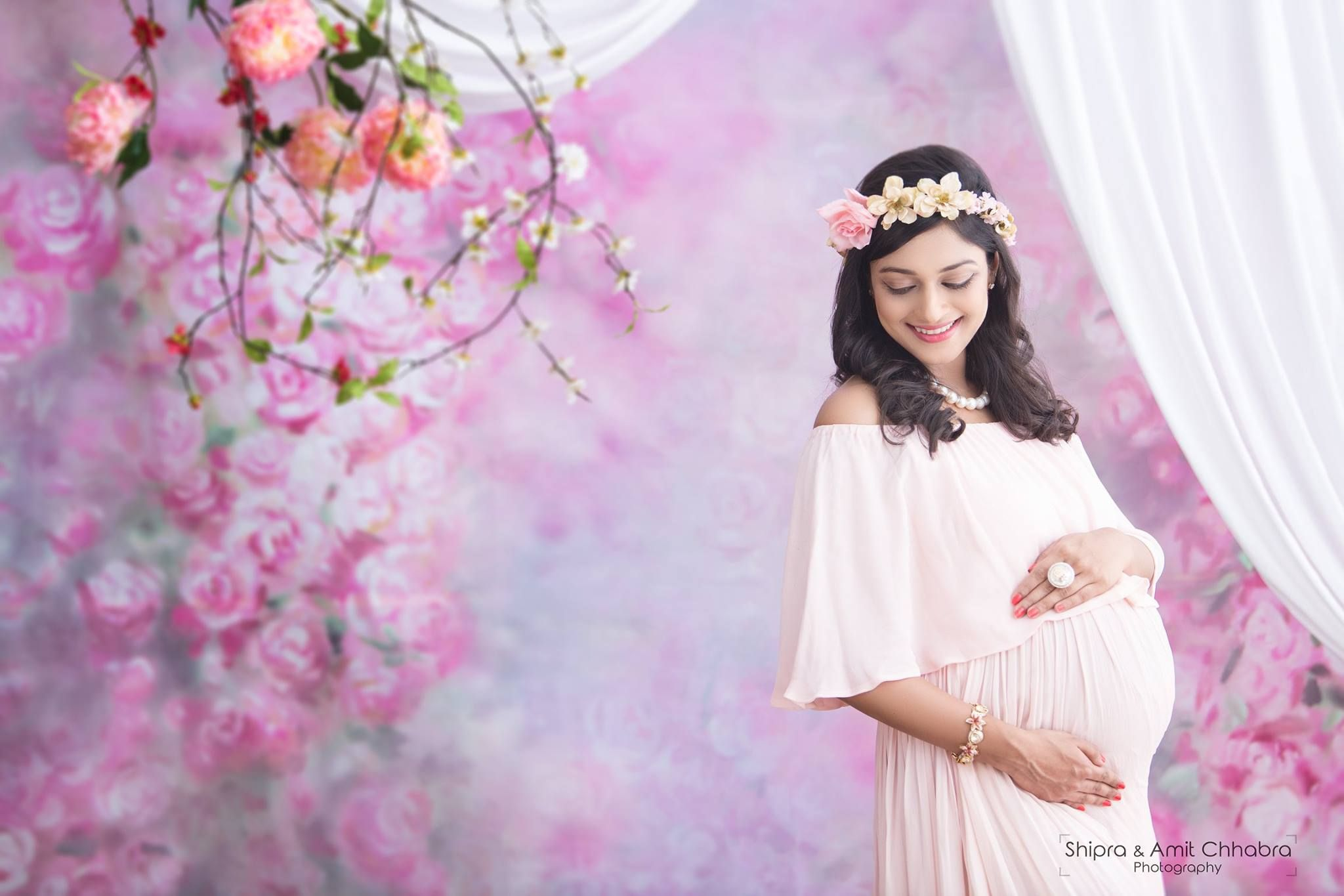 d88db59e75e8d Maternity Photoshoot Ideas. Indoor Shoot. Floral sets. Pink flowers. Maternity  Gowns. Maternity Tiaras.