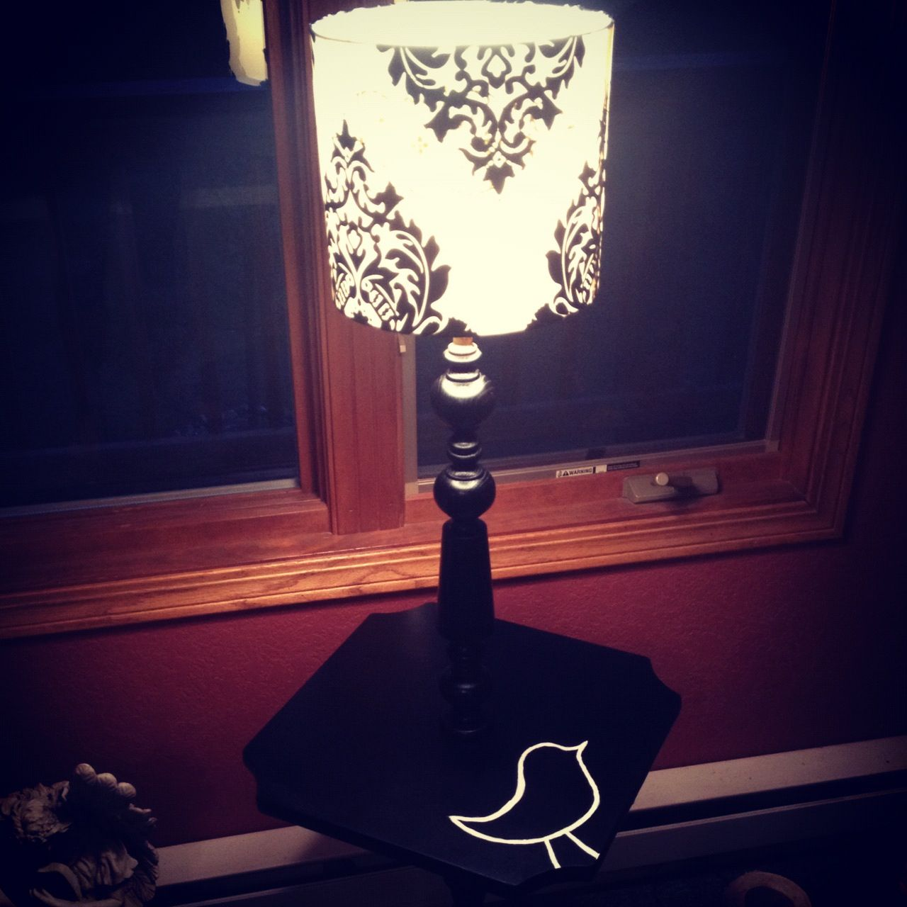 Newest pintrest project :) old lamp stand, spray painted black, new lamp shade and a painted little birdie to tie it all together  :)