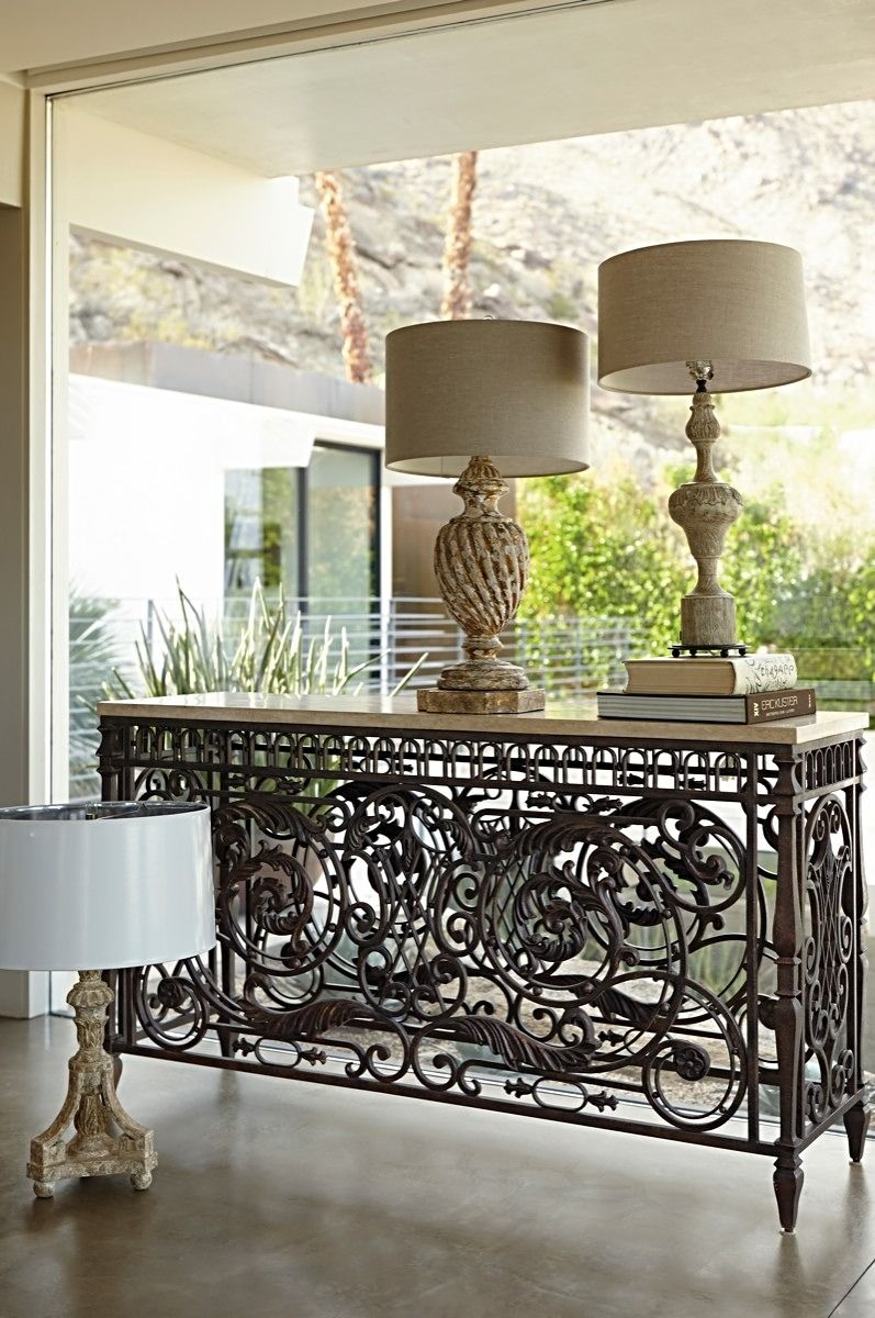 Intricate Wrought Iron Wraps Around All Sides Echoing The