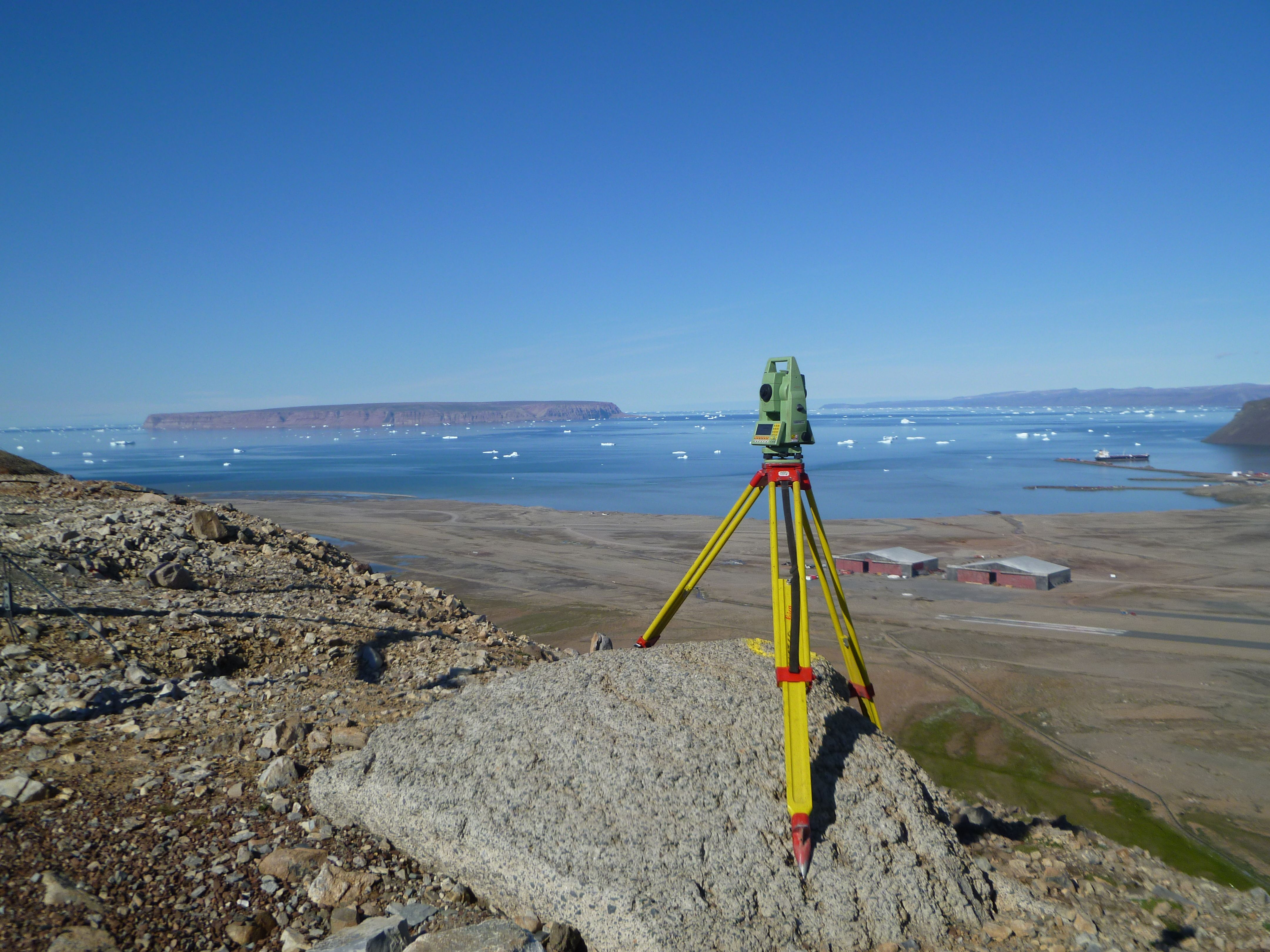 Surveyors Instrument And Tripod Taken Overlooking Thule Air Force