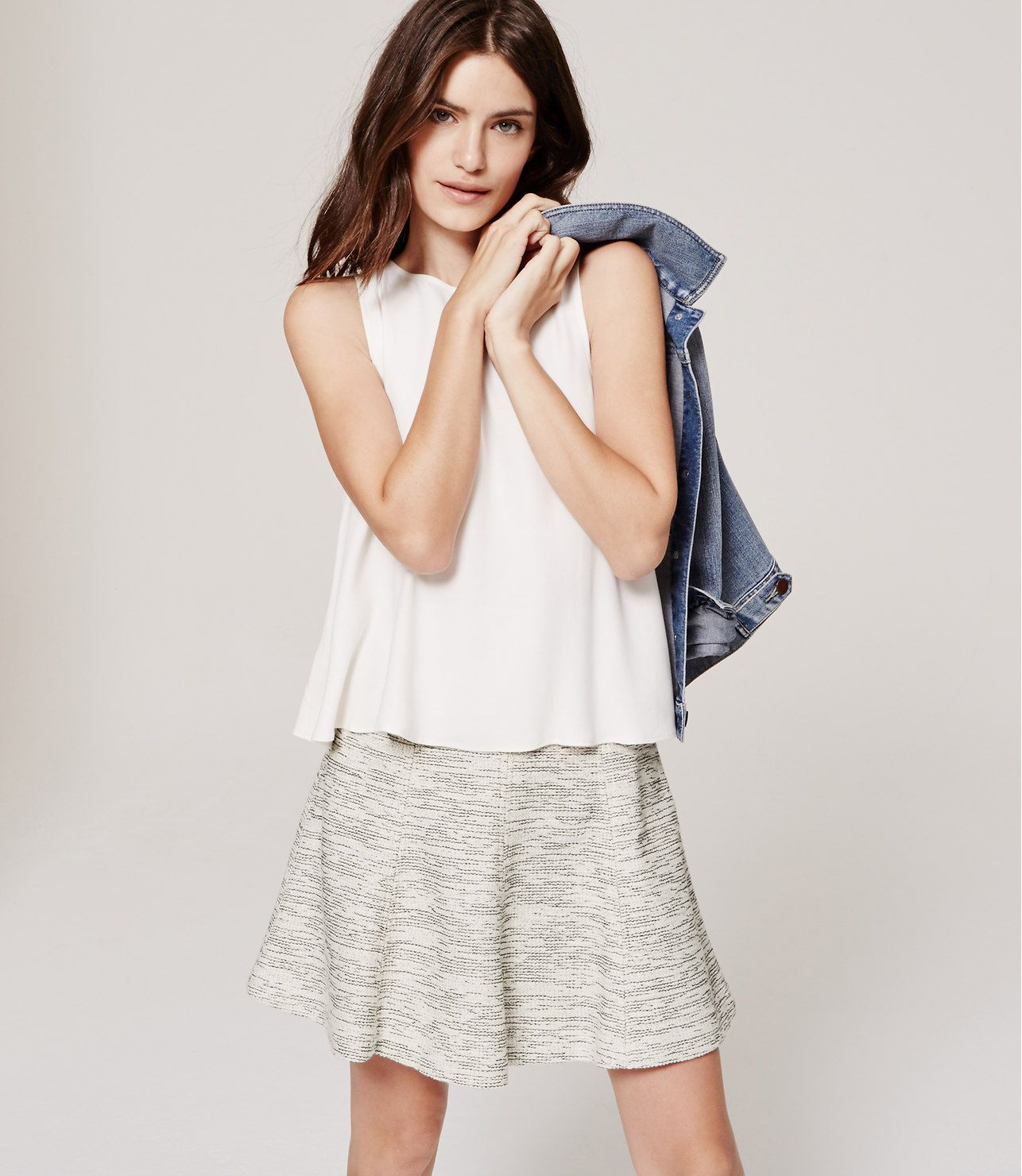 Done in a tweedy salt-and-pepper knit, this skirt is made ...
