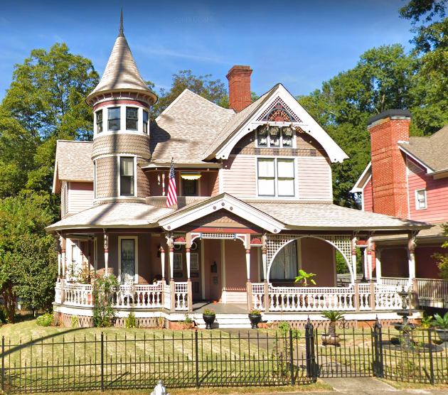 Delightful Queen Anne Style Wooden Victorian Period House In Atlanta Georgia Beautiful Pink And Coral Color S Victorian Homes House Exterior Storybook Homes