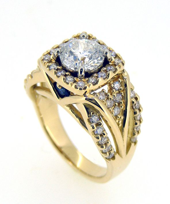 18ct Yellow Gold Engagement Ring. 1ct Brilliant Cut Diamond Center Stone surrounded by 46 0.01ct Brilliant Cut Diamonds and 2 x 0.06ct Australian Sapphires.