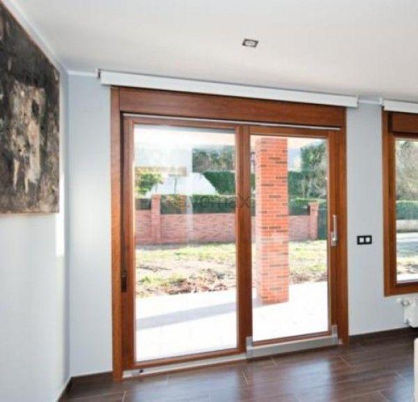 Puertas correderas osciloparalelas en madera aluminio for Puertas osciloparalelas