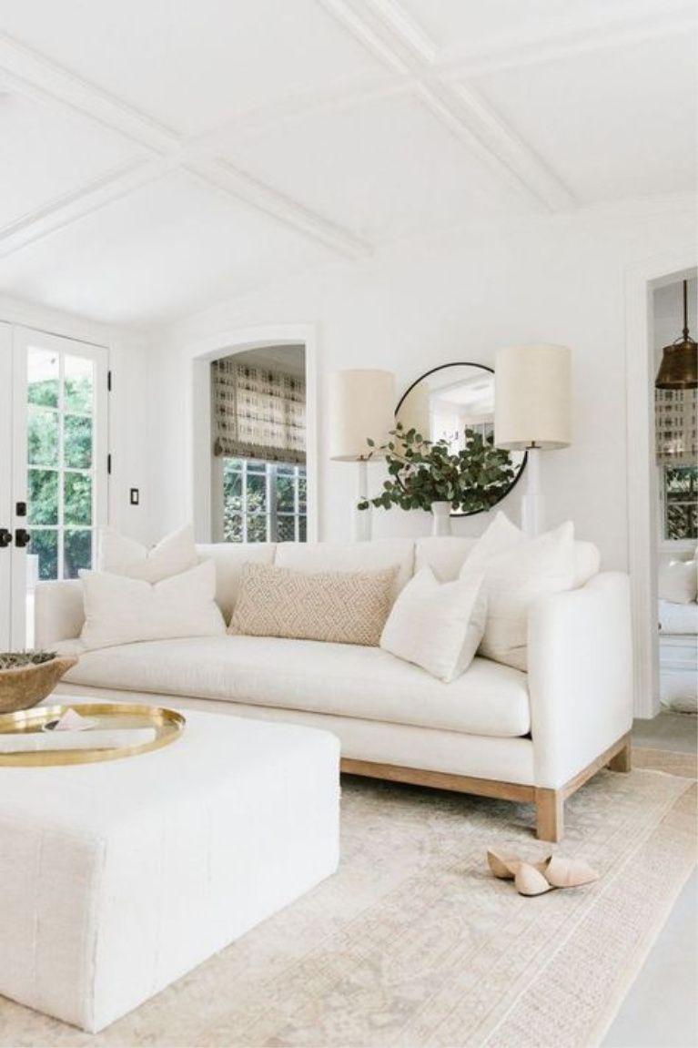 Erin Fetherston white living room with organic, modern farmhouse decor style.