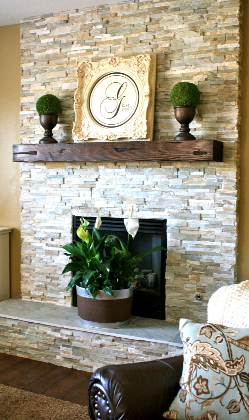 Stacked stone fireplace designs and the decors around them white