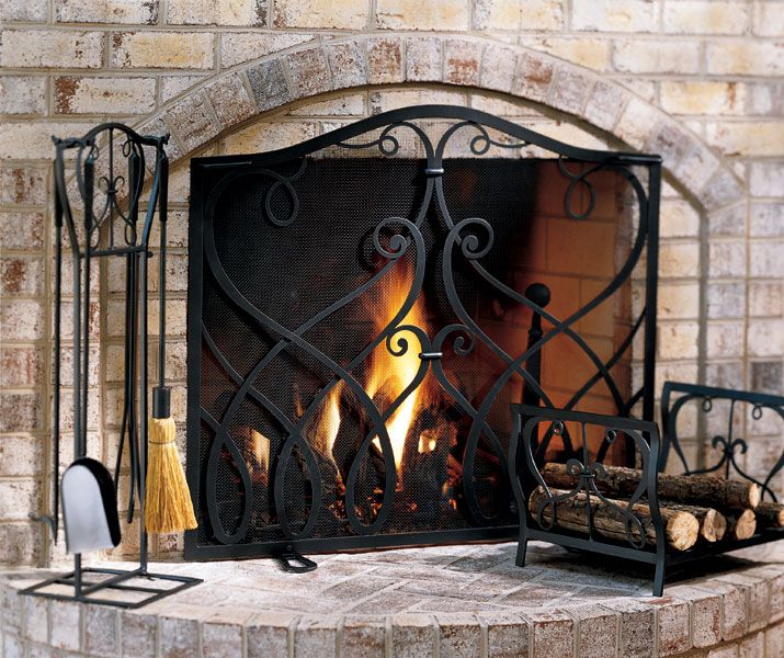 Wrought Iron Fireplace Screen. Stone Color Brick.