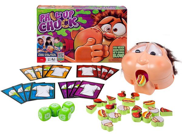 game box with plastic head eating a toy hot dog, sets of playing cards with clean t-shirts on them, four green dice, and about 20 foam food game pieces