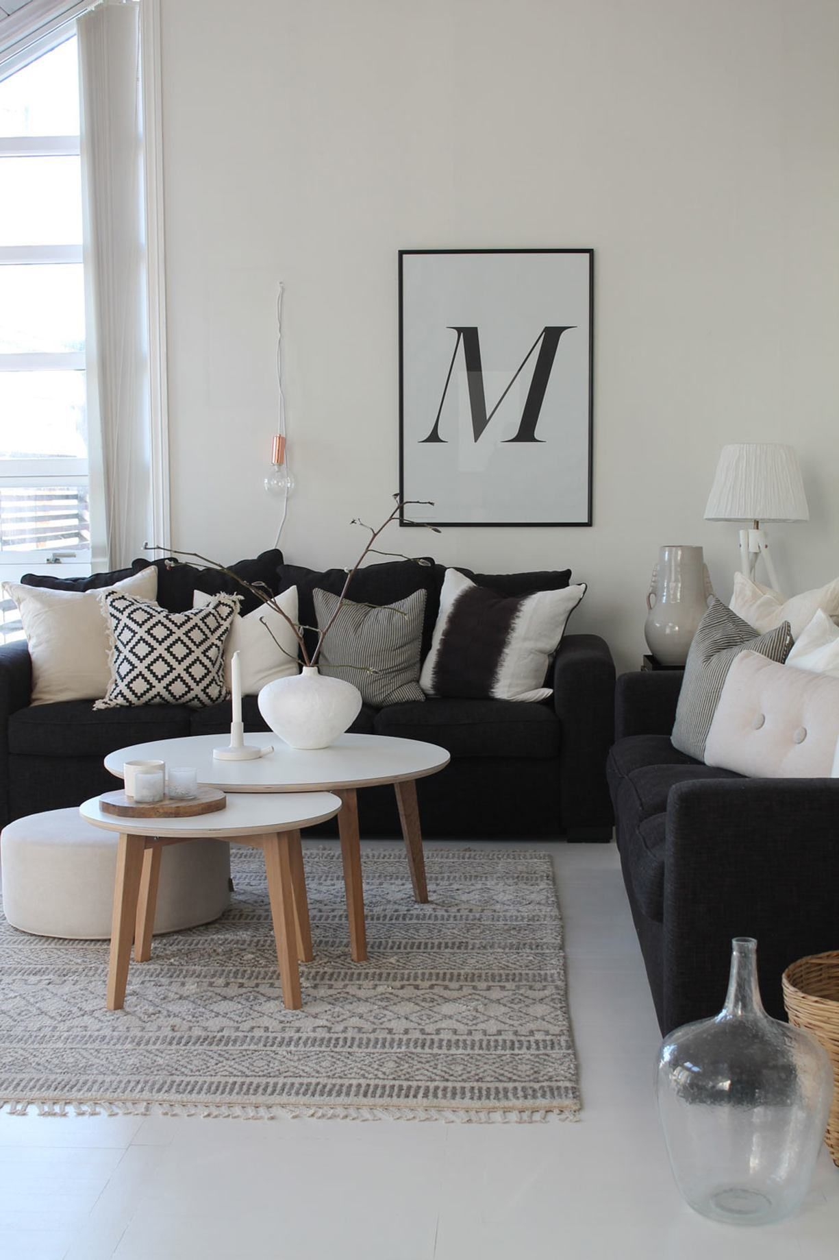 black & white with some textures pillows rug wood baskets