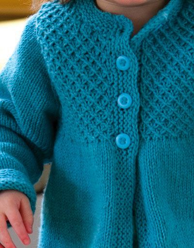 5d791b4bacd Princess Child's Smocked Cardigan **free patt** The body of this sweet  little cardigan is knit in one piece from the bottom up and the stitches  are ...