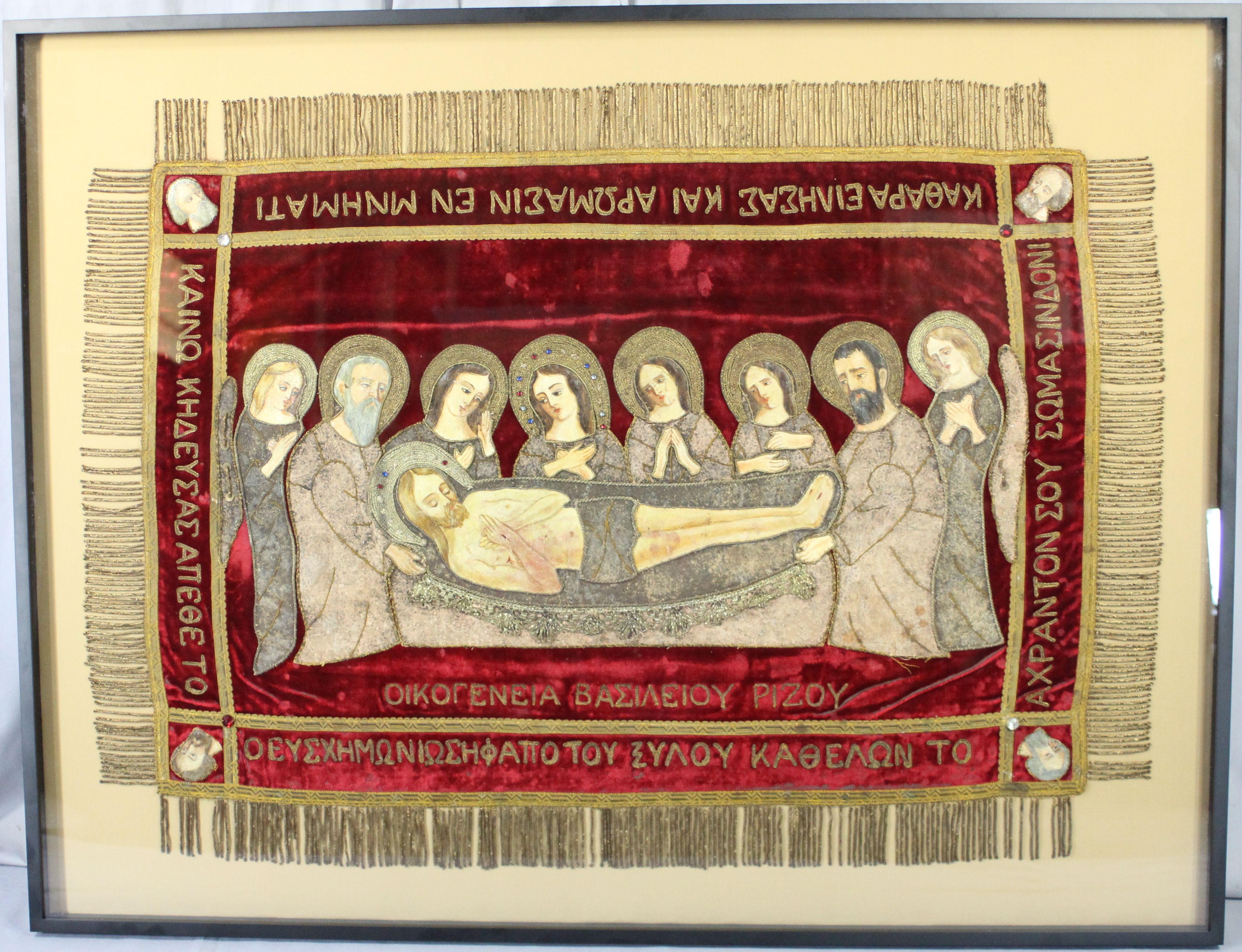 """The conservation of religious or ceremonial textile artifacts is done with care and concern for the artifact's use and importance. This particular """"Epitaphion"""" was carefully stabilized, cleaned and framed with archival materials. It has been an iconic textile for a church for over 100 years and its longevity is important."""