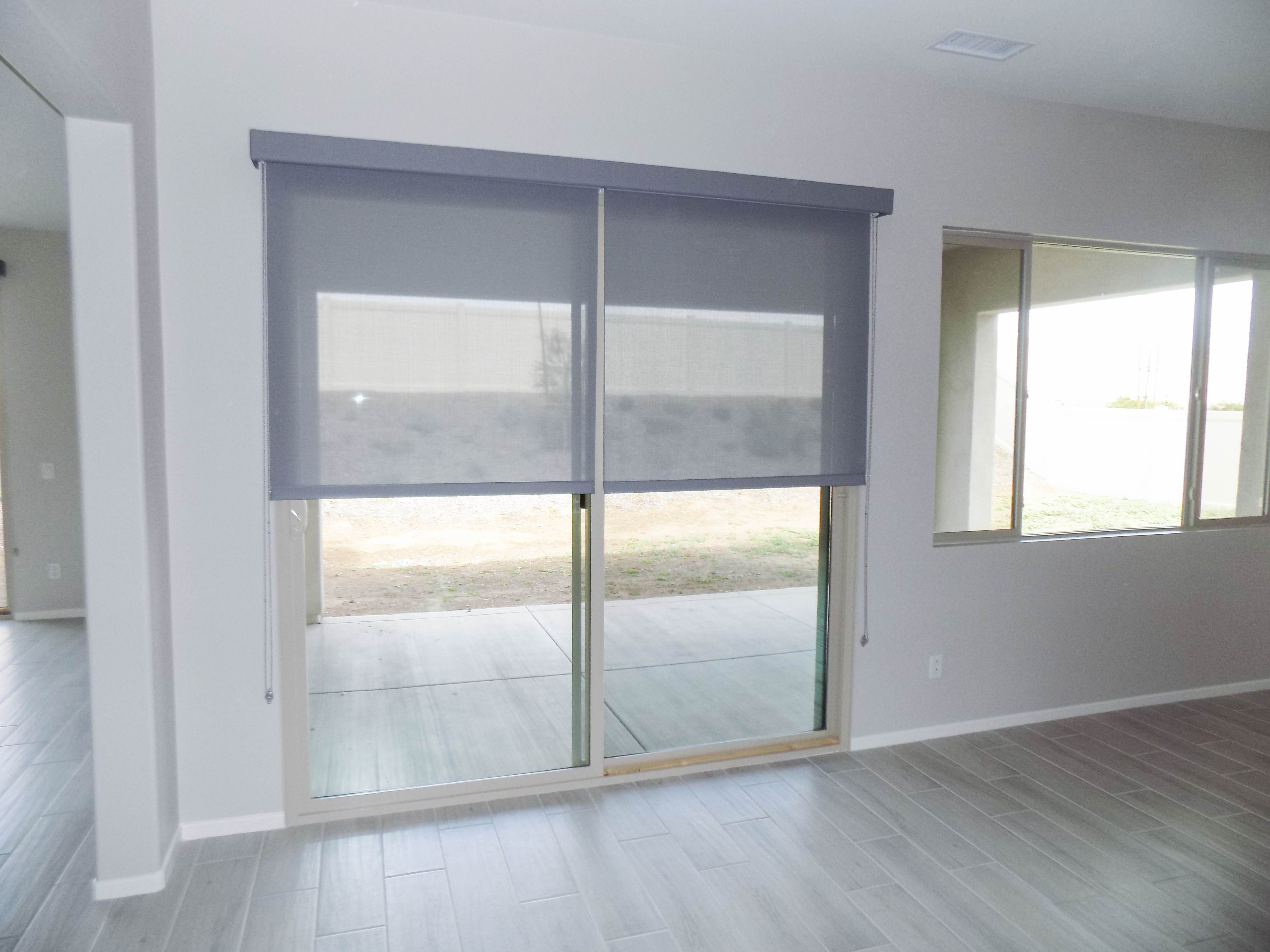We installed these indoor translucent roller shades over a sliding