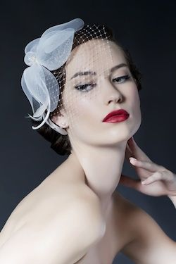 Find Couture Bridal Veils, Bird-Cage Veils and fascinators from Sara Gabriel.  French net, feathers and crystals.  Add a touch of drama to your wedding day look.