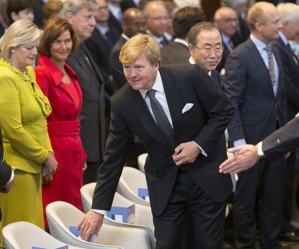 King Willem-Alexander of The Netherlands takes his seat beside United Nations Secretary General Ban Ki-moon during an event to mark the centennial anniversary of the Peace Palace at the Peace Palace on 28 Aug 2013 in The Hague, Netherlands