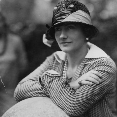 Coco Chanel , With her trademark suits and little black