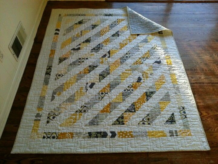 Yellow and grey quilt made by Lauren