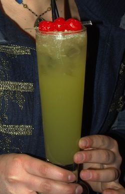 Jon Pertwee The Green Death cocktail Doctor Who  Shake two parts overproof rum, one part Midori, and four parts pineapple juice and pour into a tall glass. Top with Sprite and add three de-stemmed black cherries. If offered assistance by any megalomaniacal supercomputers, refuse politely but firmly.
