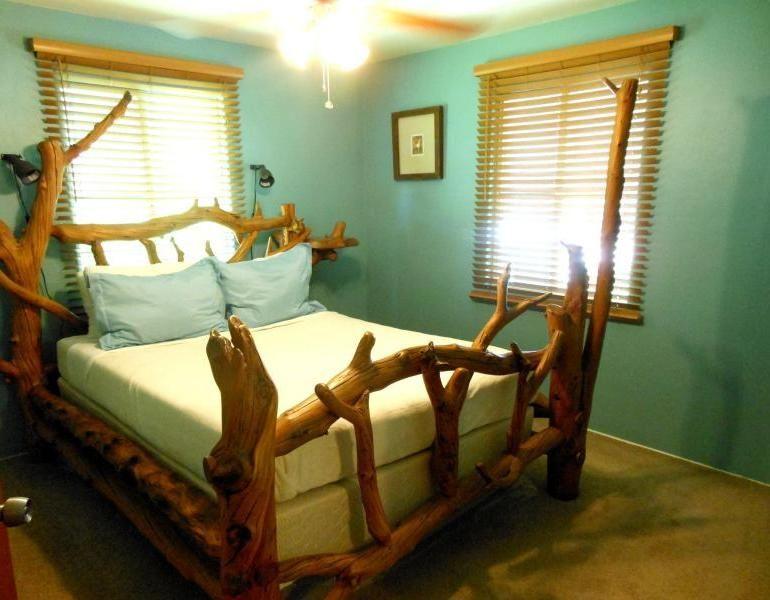Strange Beds odd weird strange bed frame made of tree logs lumber timber trunks