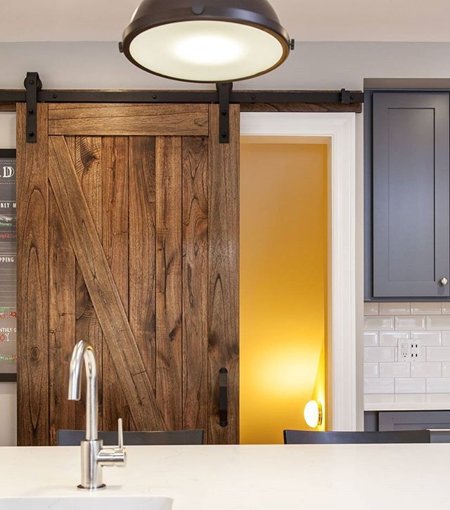 Grey cabinets with a barn door and a pop of yellow. This ...