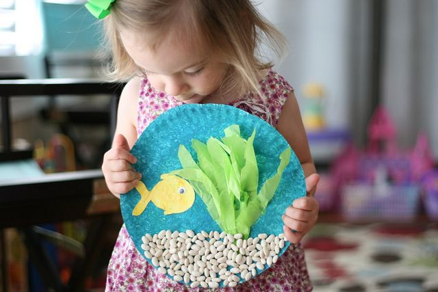 Under the sea. → Materials: paint, paint brushes, paper plate, white card stock, green and yellow tissue paper, white beans, fish template, school glue, and one googly eye.