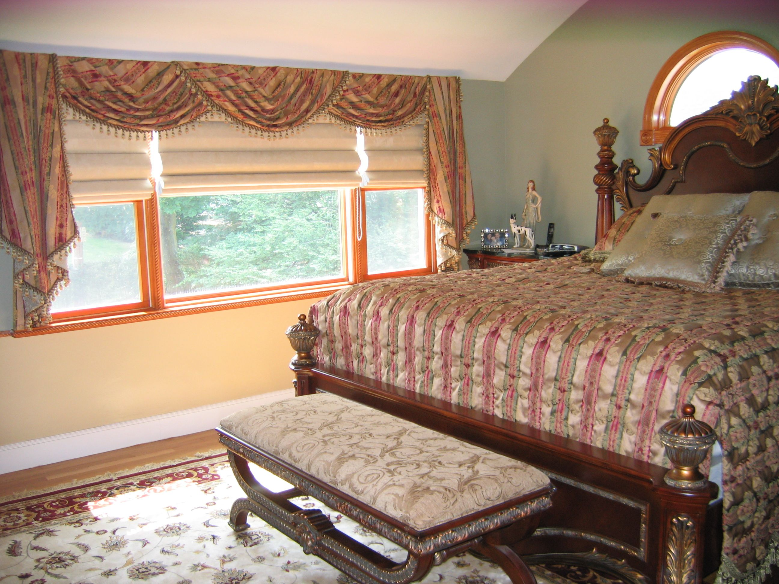 Bed covering window  traditional swags with double cascades over roman shades custom