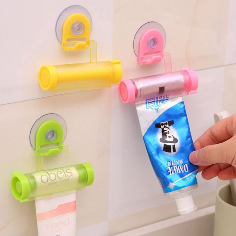Useful Toothpaste Tube Squeezer Easy Dispenser Rolling Holder Bathroom Supply