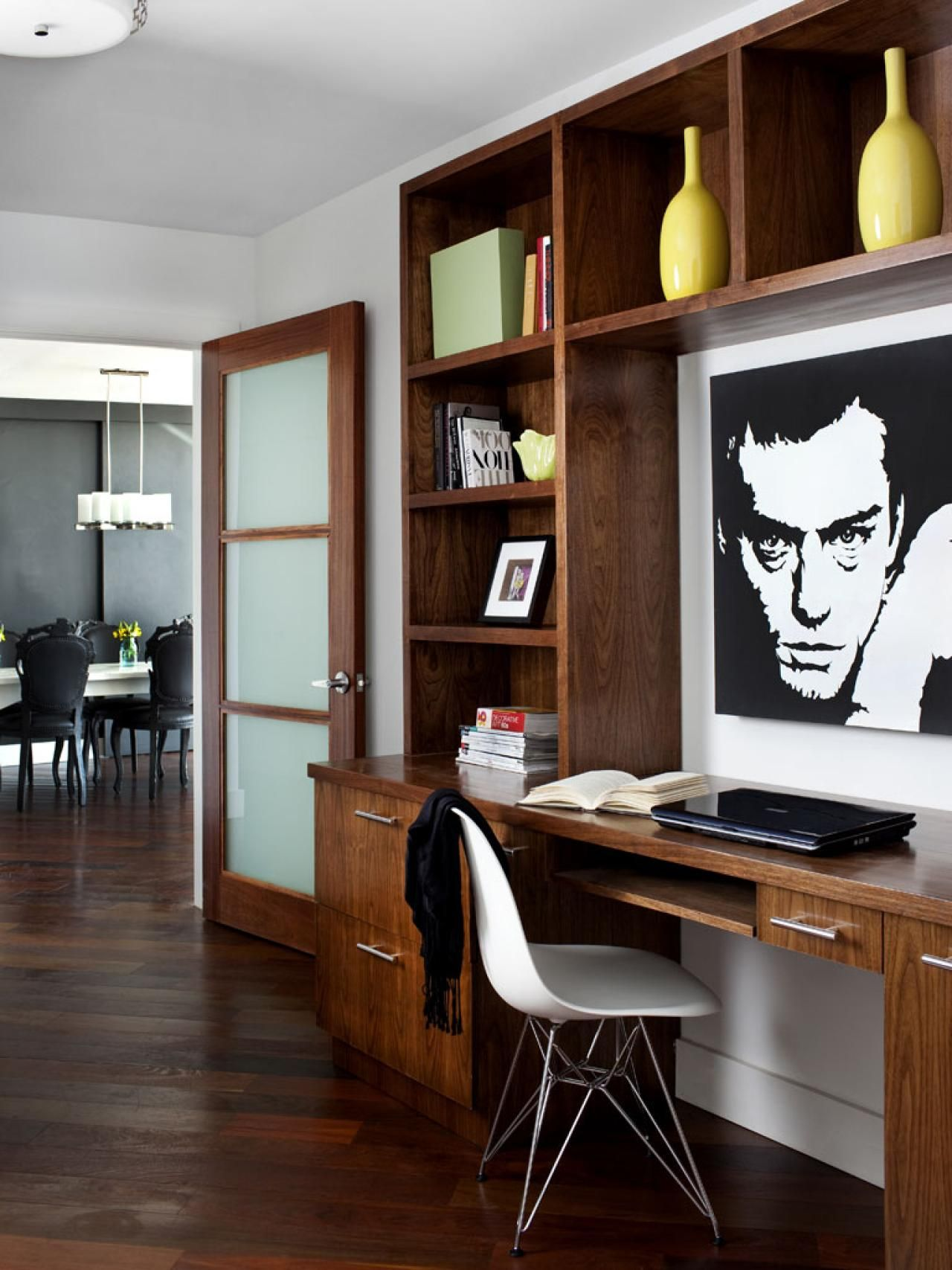 In This Home Office Which Has Gorgeous Dark Wood Floors A Wood Desk Is Paired With A Built In Shelving Unit Used To D Modern Home Office Home Dark Wood Desk