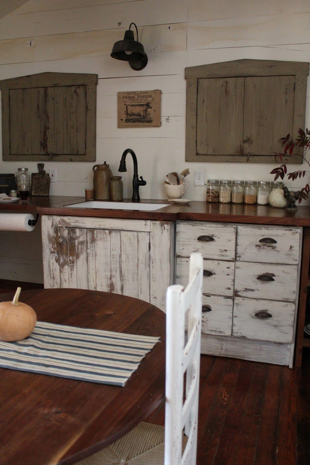 A fine farmhouse kitchen acupboard like one ofthese would make a