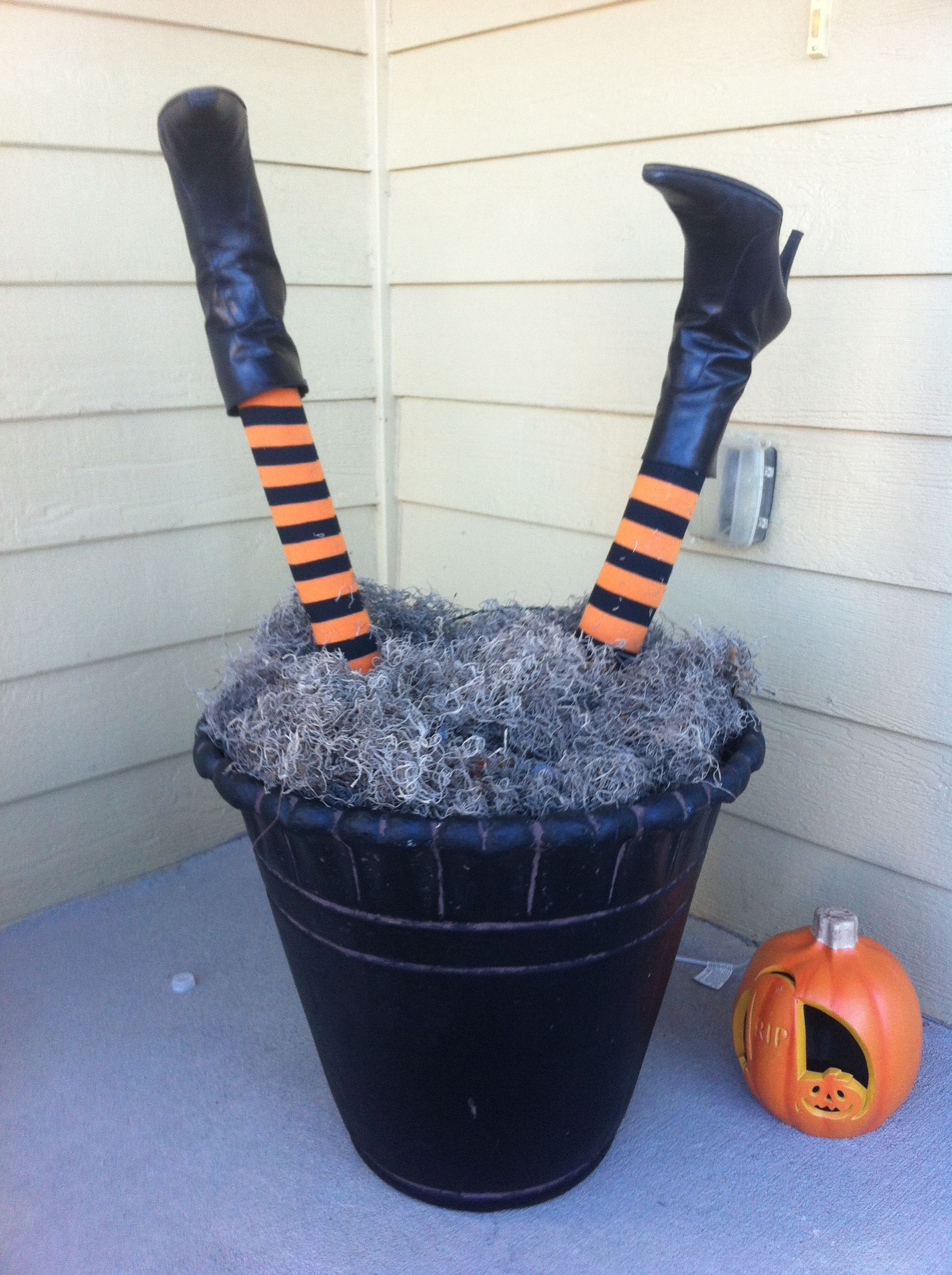 Our cute witch legs! Pool noodle with Halloween socks and shoes from - Wizard Of Oz Halloween Decorations