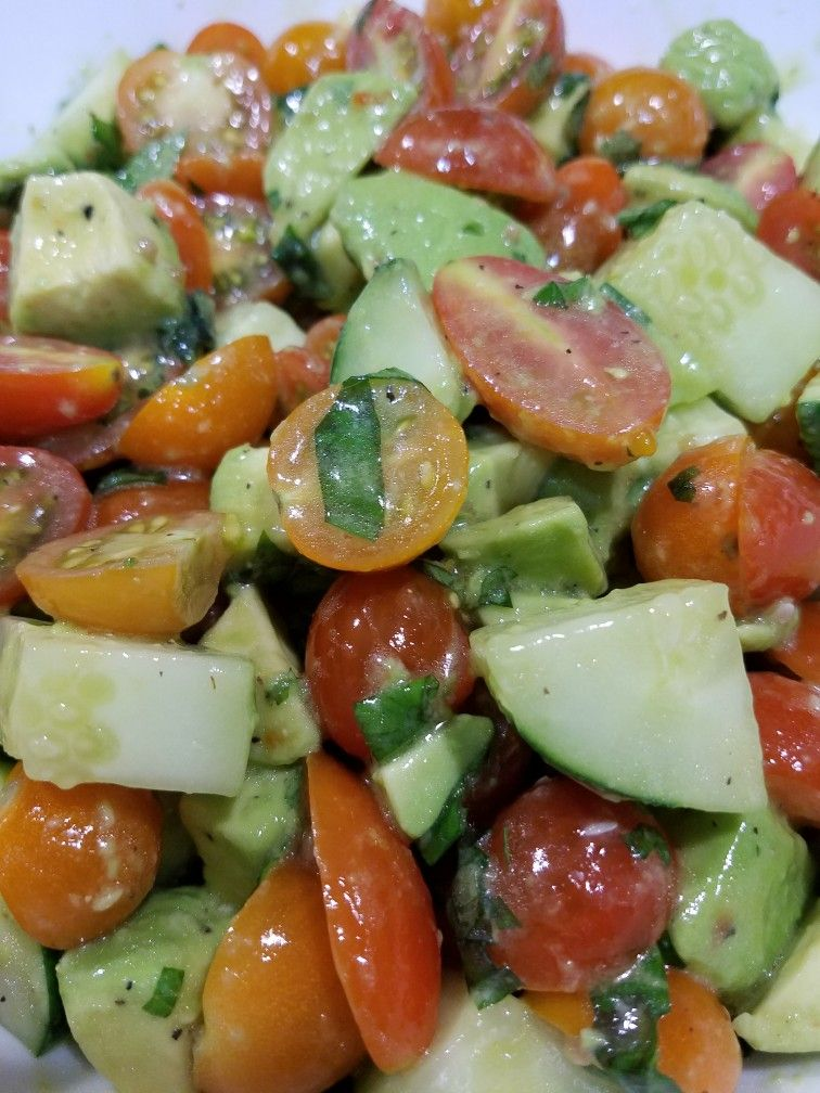 Summer Salad: tomatoes, cucumber, avocado, chopped mint and basil, italian dressing olive oil, salt and pepper.