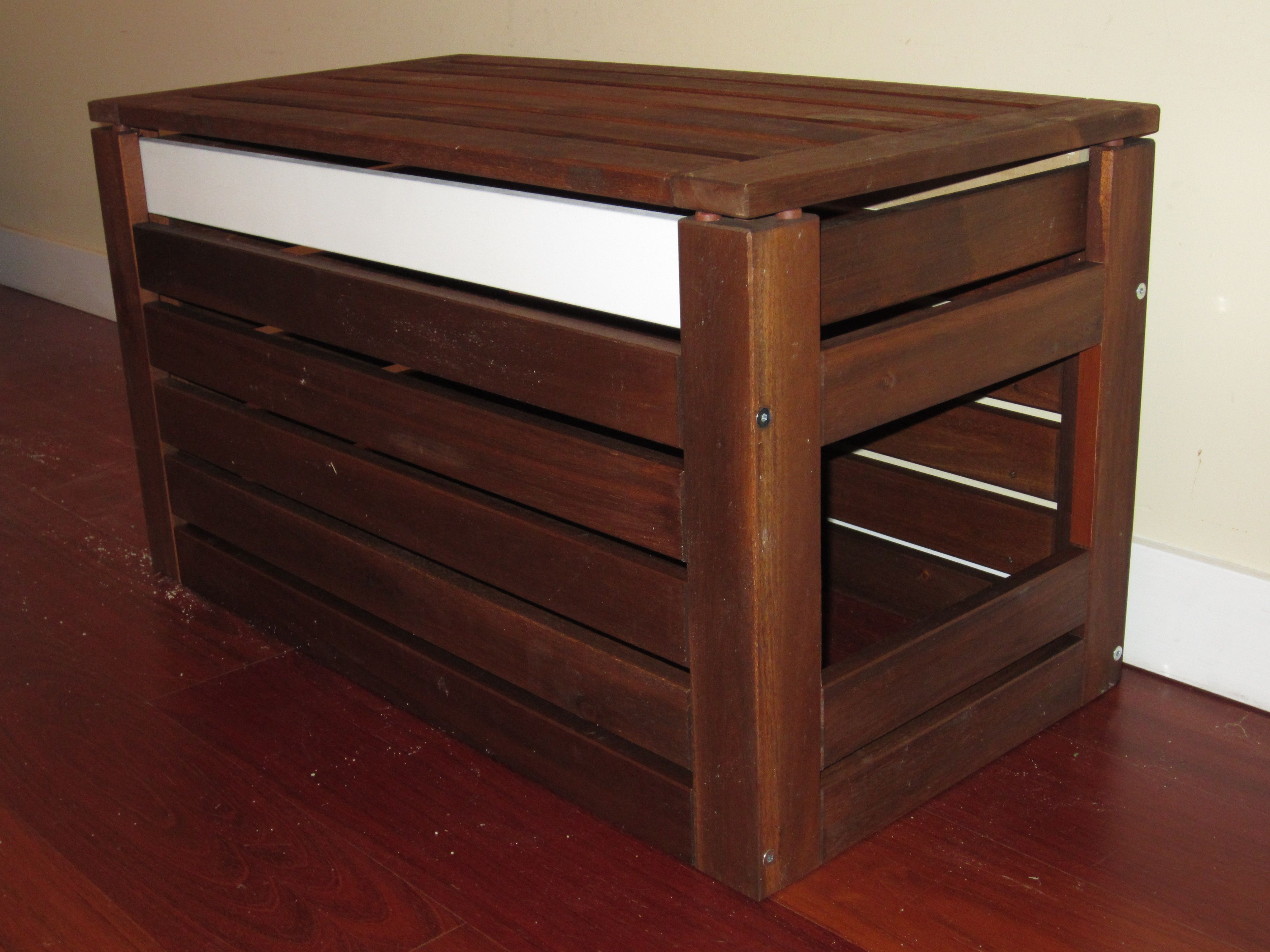 Build a wooden crate to hide the cat litter box maybe